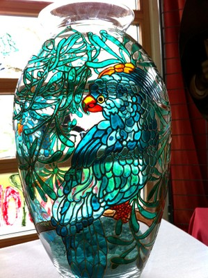Vase en transparence avec perroquet