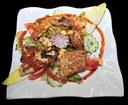 Piccata de carpes sur sa salade folle, aux 3 Vallées à Hirsingue- «Sundgau routes de la carpe frite» organise jusqu'au 22 avril 2012 une grande animation autour de la carpe. Photo JP Girard