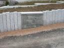 Mur en pallissade et pierre sèche