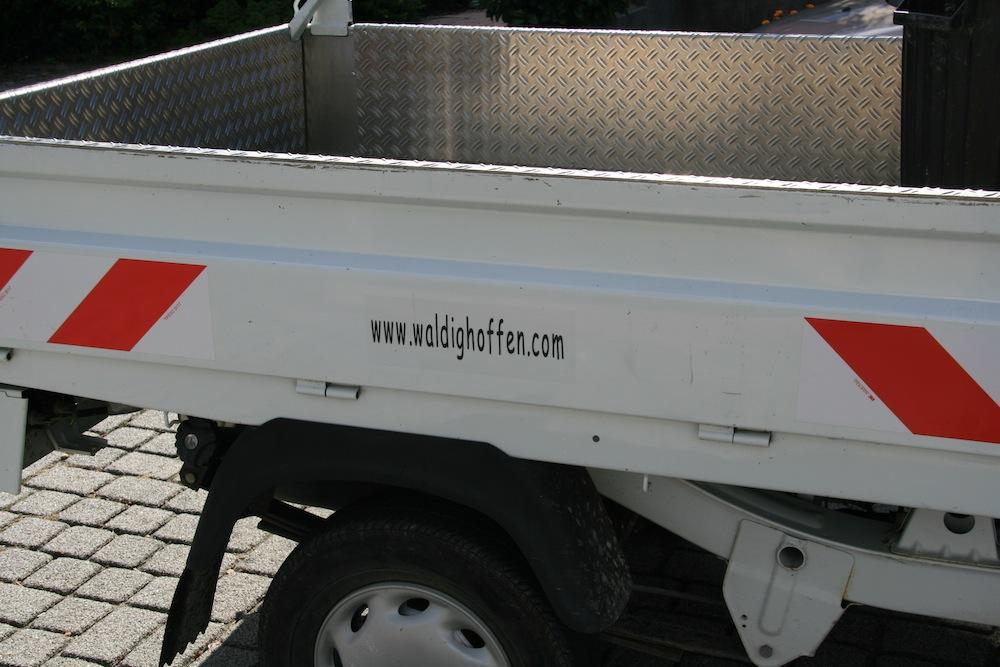 Benne du Piaggio avec adresse du site